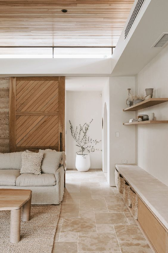 a stylish modern light-stained wooden door with a pattern is a cool solution for a modern neutral space and it adds a warm touch