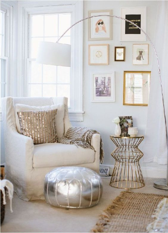 a super glam nook with mixed metals - a silver Moroccan pouf, a gold side table, a gold pillow, a floor lamp on a chromatic leg