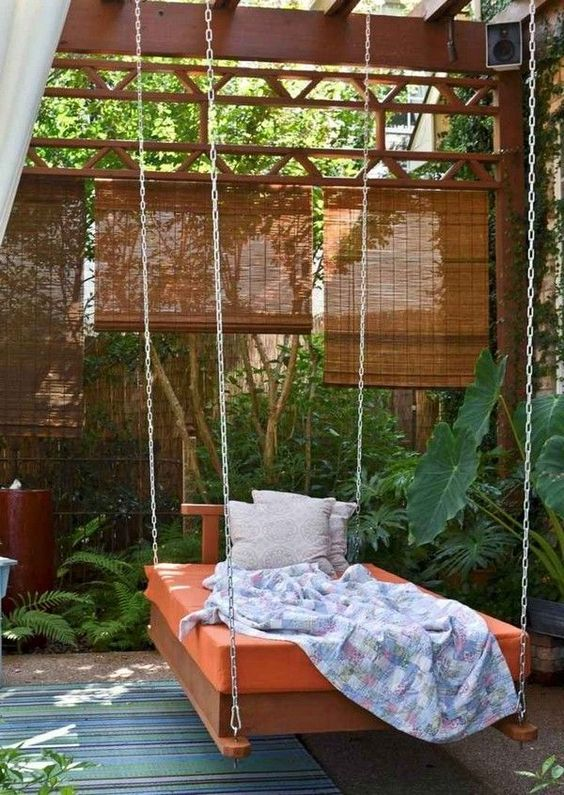 a cozy pergola surrounded by greenery