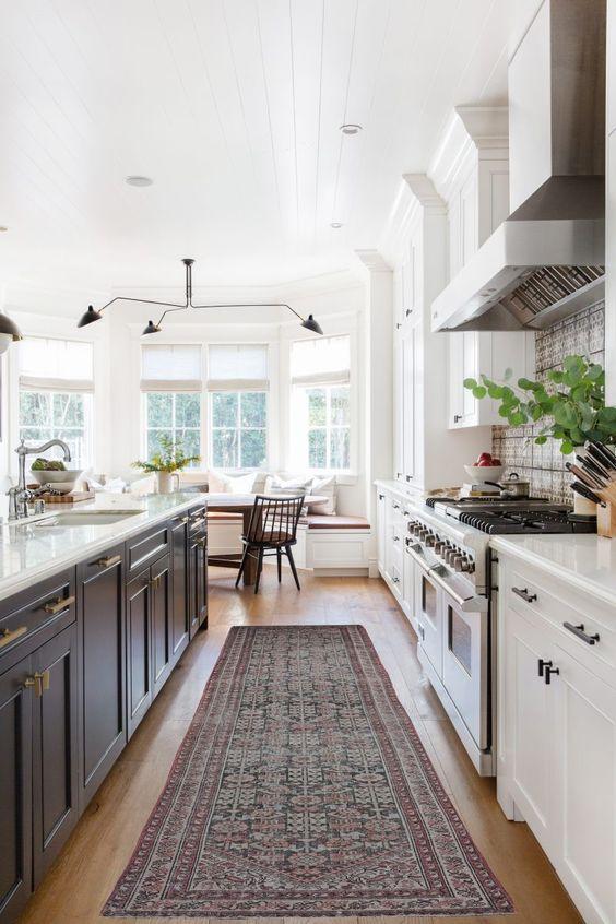 a stylish farmhouse two tone kitchen design