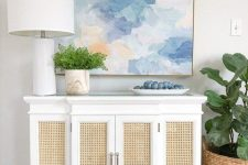 a vintage dresser with cane doors looks very relaxed and coastal-chic like, despite of the vintage design