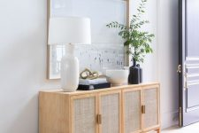 an elegant cane sideboard with cane doors is a lovely and stylish alternative to a usual console table in the entryway