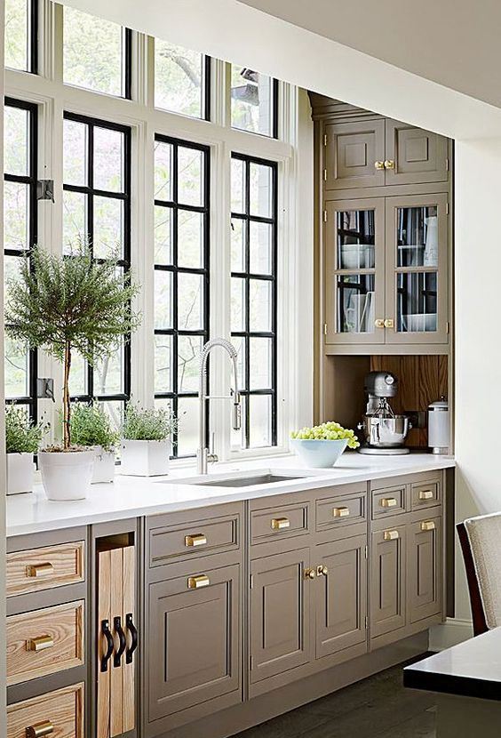 an elegant farmhouse kitchen with gold knobs, chromatic fixtures and appliances is a very elegant idea and the kitchen looks veyr cohesive
