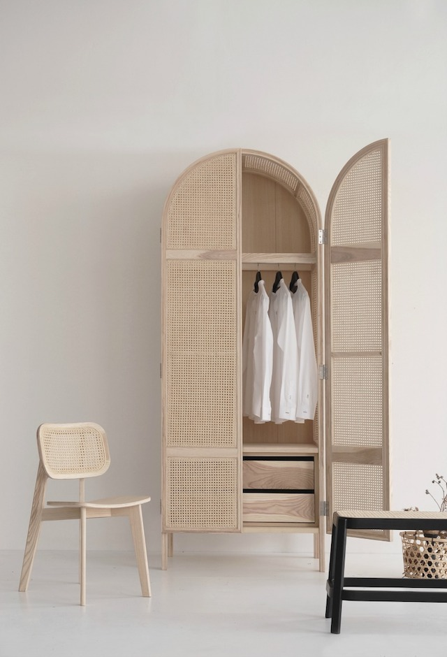 an ethereal looking cane mini wardrobe is a beautiful lightweight furniture item is a chic idea for a modern space