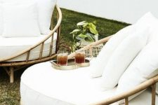 lovely rounded bamboo chairs with white upholstery are amazing for styling any outdoor space and look very elegant