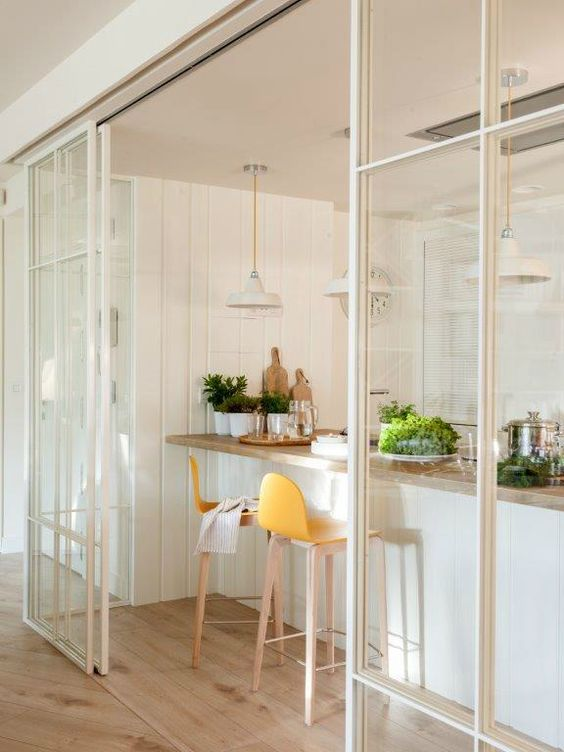minimalist glass white sliding doors are ideal for separate a kitchen and a living room or some other room