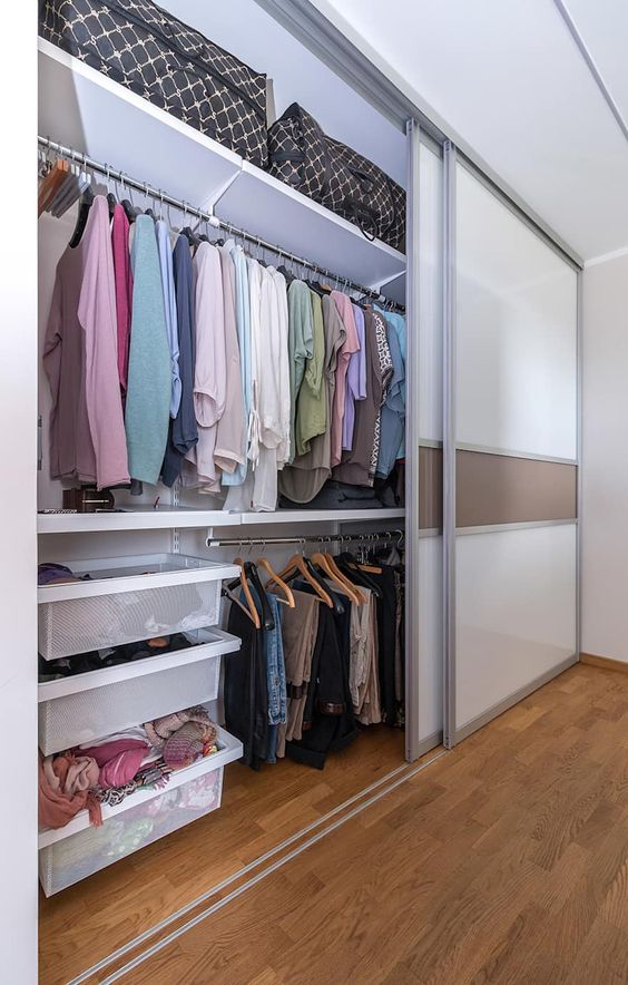 modern glass and plastic sliding doors keep the closet hidden and declutter the space this way making it sleek and cool
