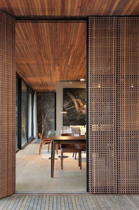 rattan net-like sliding doors add a warm touch to the space and add a vacation feel to the rooms at the same time