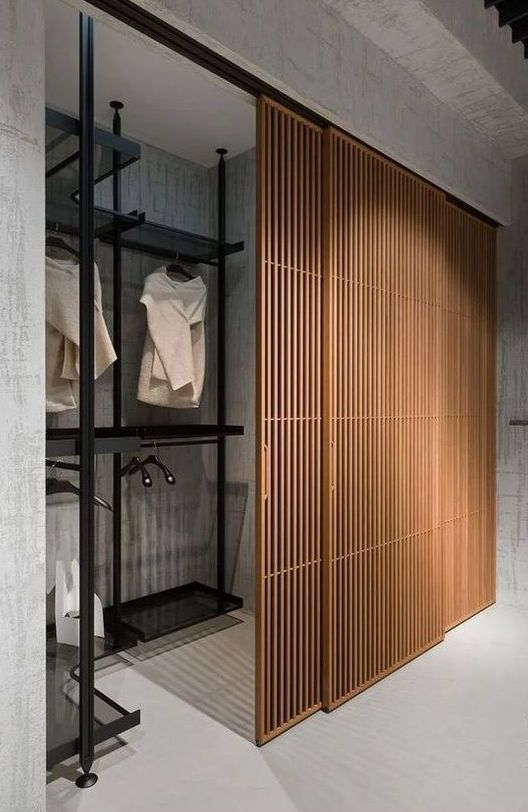 separate the closet and the bedroom with delicate wooden slab sliding doors and achieve a non-cluttered and chic look for a contemporary space