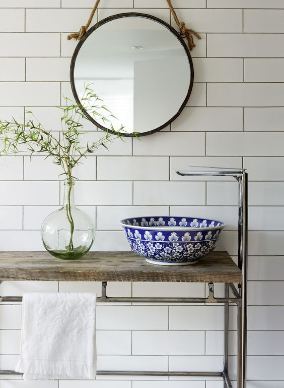 a beautiful blue floral pattern vessel sink is a lovely solution to add a touch of pattern and color to the space and refresh it