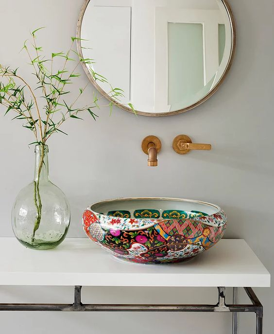 a bright painted vessel sink and brass fixtures will add color and pattern to any neutral bathroom and will make it look ultimate
