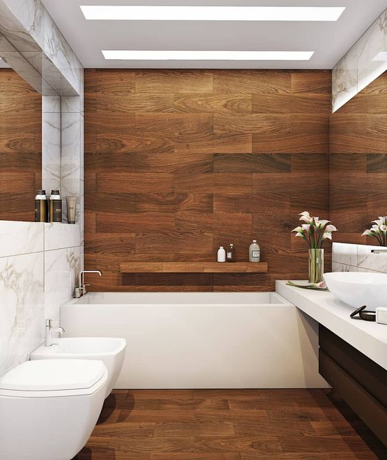 a chic bathroom clad with wood look tiles, with white appliances and a floating vanity plus skylights is a very cool space