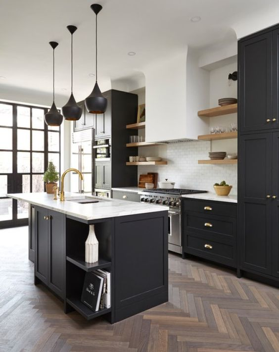 a chic black kitchen with shaker cabinets, white stone countertops, floating shelves and a white subway tile backsplash