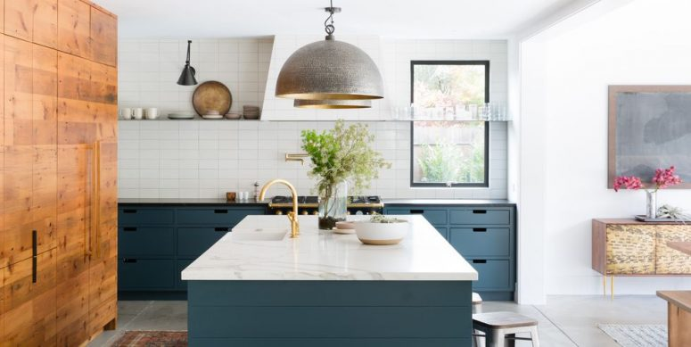 a contemporary blue kitchen with a white tile backsplash, a white hood and a skinny floating shelf for storage