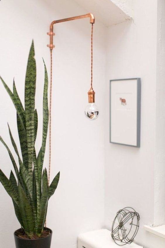 a copper sconce is always a good idea, it's a pretty and elegant touch of industrial style to the space