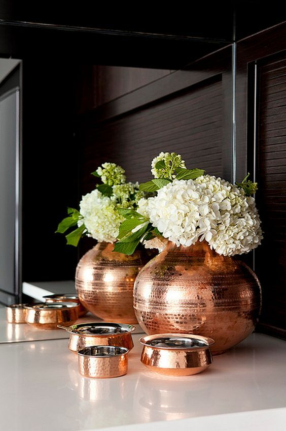 a copper vase and jars are great for rocking them in your space, they give a soft and warm feel to the space
