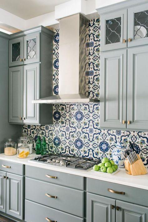 a gorgeous grey farmhouse kitchen with white stone countertops, a bright Moroccan tile backsplash and metallic touches is very elegant