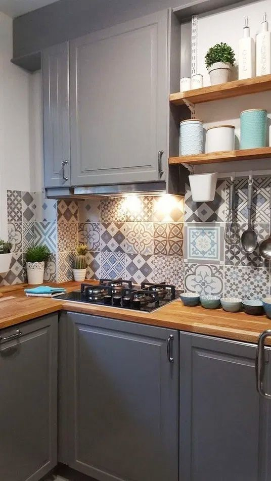 a grey farmhouse kitchen with light-stained countertops, a pretty Moroccan tile backsplash and built-in lights is amazing