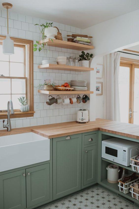 a lovely green kitchen design