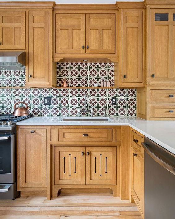 a light stained kitchen with a bright Moroccan tile backsplash and white stone countertops is a lovely idea to rock