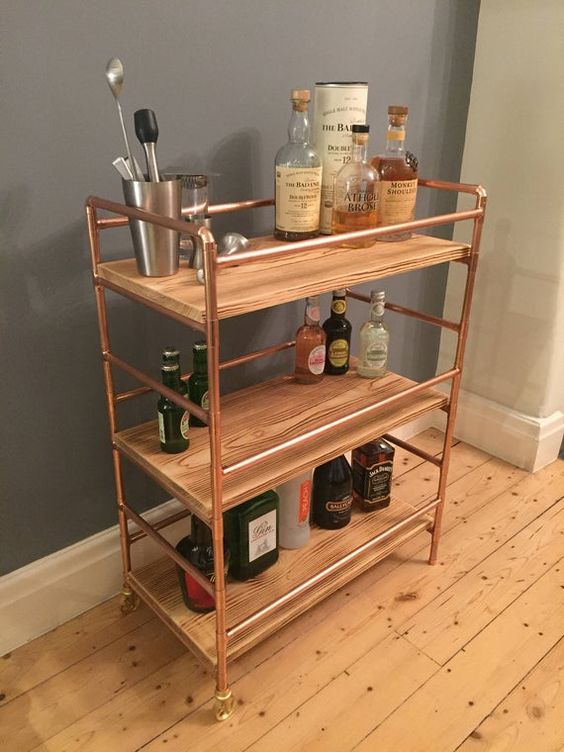 a lovely and lightweight bar cart is a pretty idea for any kitchen, living room or dining room and it adds warm glow to the space