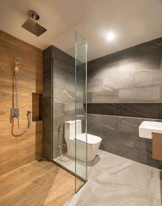 a minimalist bathroom clad with grey stone and wood look tiles in the shower, white appliances and lights is a lovely idea
