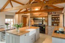 a cozy modern farmhouse kitchen design with wooden beams