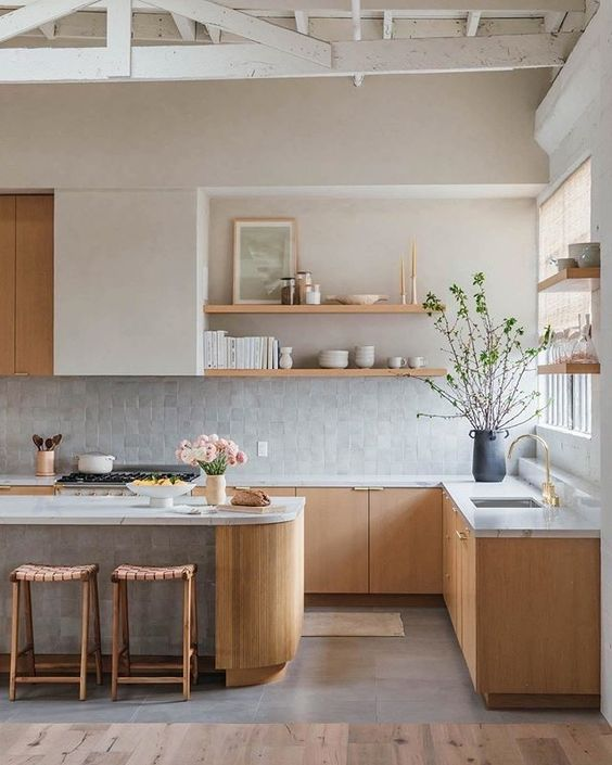a neutral Japandi kitchen with light-stained cabinets, a white upper cabinet, a large kitchen island and open shelves