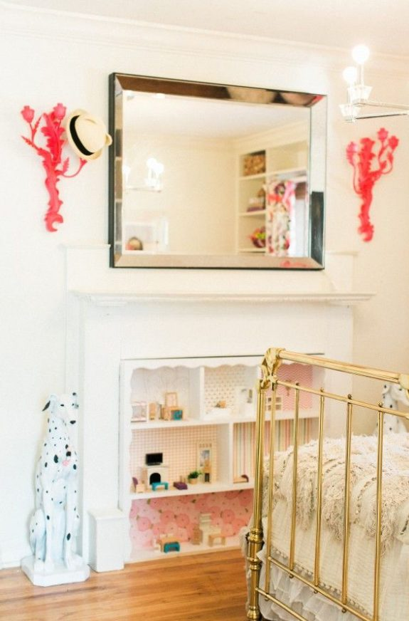 a non-working fireplace turned into a doll house is a lovely and fun idea for a little one's room