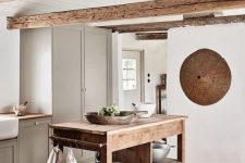 a cozy kitchen with lots of wood