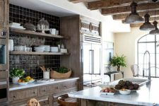 a cute kitchen with wooden cabinets