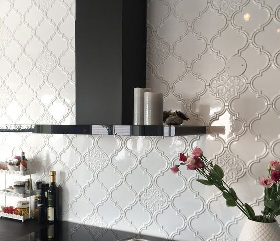 a shiny and polished black kitchen with white arabesque tile backsplash is a very elegant and chic idea to make a statement