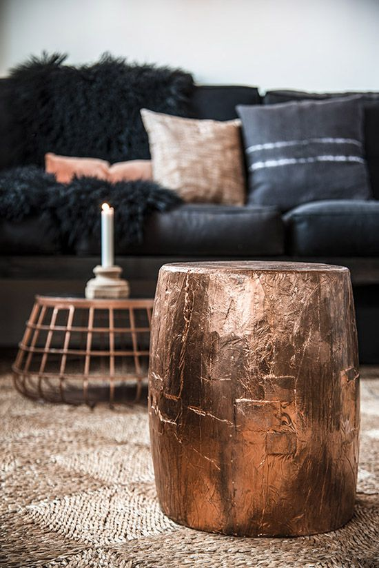 a side table covered with copper leaf and a coffee table with a copper base are very lovely decoraitons to rock