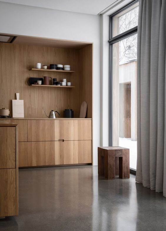 a sleek Japandi kitchen with light-stained cabinets and open shelves, a floor to ceiling window, a stained stool is a very inspiring space