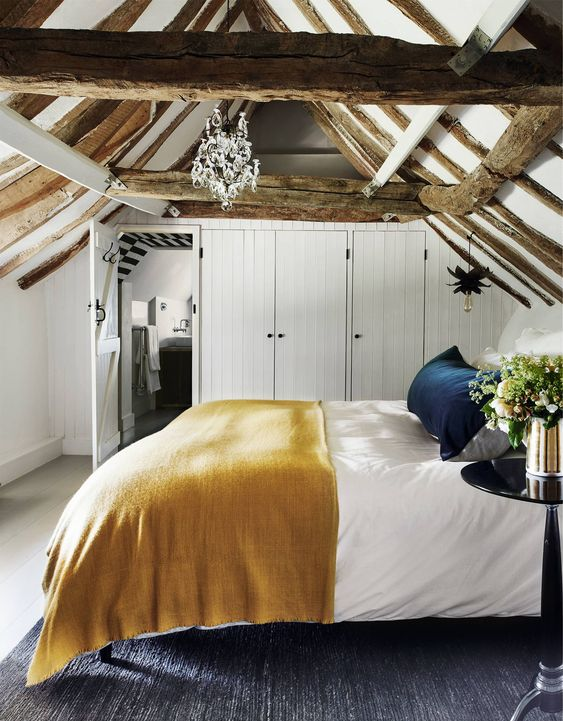 a small yet cozy attic bedroom design with rustic touches