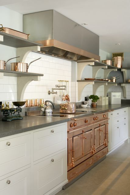 a stylish neutral kitchen with open shelves instead of upper cabinets, a copper cooker and a hood with a copper touch is chic