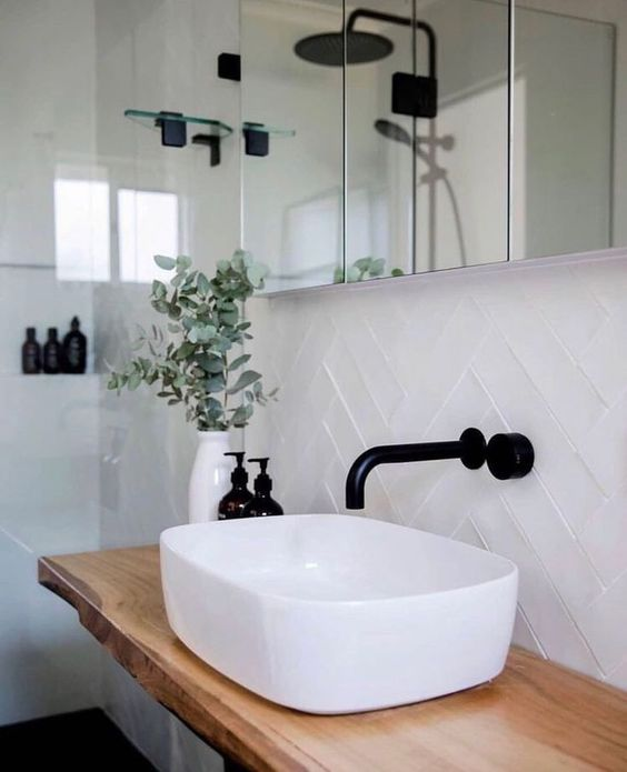 a white rounded square vessel sink is a beautiful and chic touch to the bathroom and it makes it look more exquisite