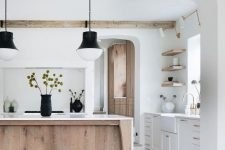 an airy kitchen with white cabinets, a stained kitchen island, wooden beams and open shelves that echo with this island is wow