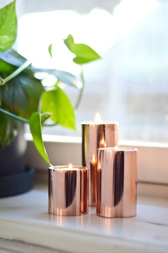 copper candleholders are great to accent your space, they look lovely and warm up the space, at least visually