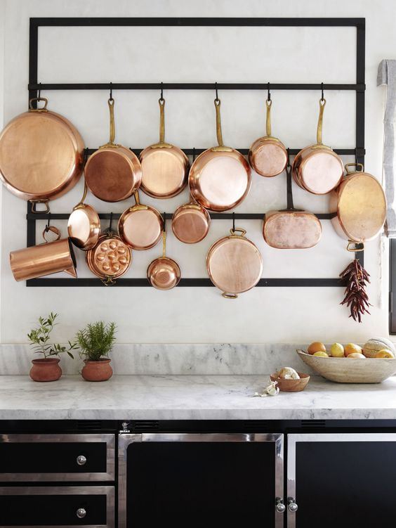 copper cookware displayed in the kitchen will make it very elegant, stylish and will give it a cozy and homey feel at the same time