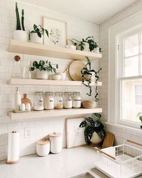light-stained thick floating shelves are great for a farmhouse space, they can be used for both storage and displaying
