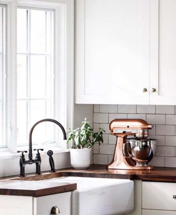 some copper appliances will give you kitchen a chic and pretty look and will make it more elegant at the same time
