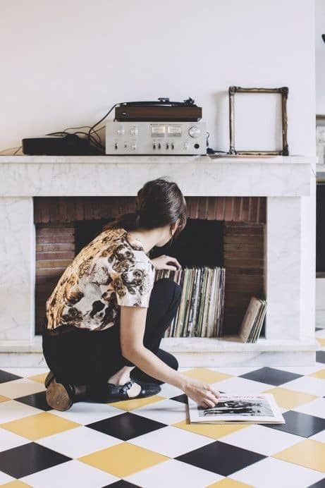 store your vinyl in a non-working fireplace - this is a very creative idea and a mantel can be used here, too
