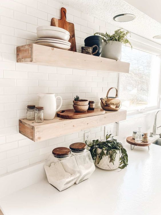 thick wooden floating shelves like these ones will add a farmhouse feel to the space and will make a statement