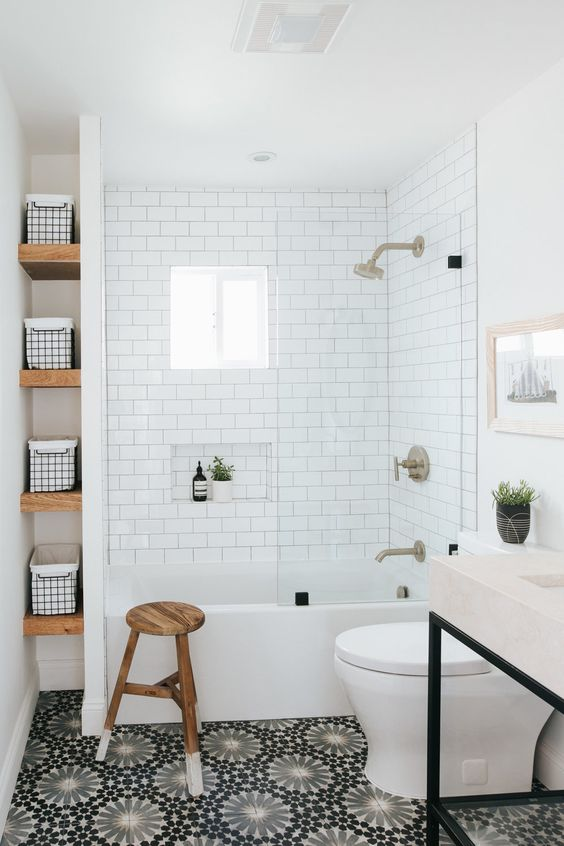 a mid century modern black and white bathroom with subway tiles and a bathtub shower space with a small window placed high