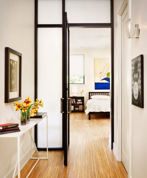 frosted glass doors, even with dark framing, separate your spaces gently without visually decreasing the amount of space