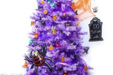 03 a bright purple Halloween tree with colorful ornaments and pumpkins, a witch hat and a spider is all fun