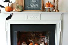 04 a fireplace with colorful pumpkins and candle lanterns easily turned into a Halloween one with black paper bats attached