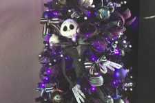 04 a purple Halloween tree decorated with white, black and purple ornaments, with Jack SKellington decor and purple glitter ribbons