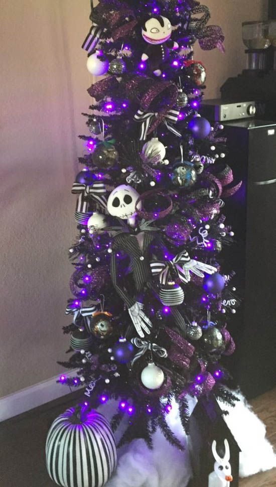 a purple Halloween tree decorated with white, black and purple ornaments, with Jack SKellington decor and purple glitter ribbons
